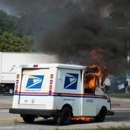 Photos taken around 5:00 PM on Red Run blvd in Owings Mills of a Mail Truck on fire outside the Royal Farms Gas Station on the corner of Red Run Blvd and Pleasant Hill Road